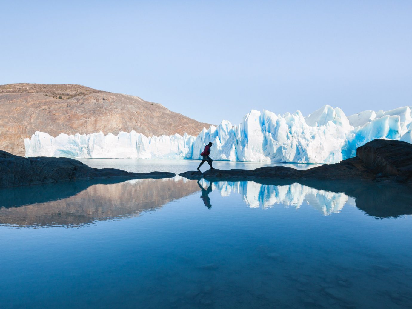 Jetsetter Guides Packing Tips Travel Tips Trip Ideas sky Nature mountain water outdoor landform reflection geographical feature Lake ice fjord loch arctic mountain range glacier glacial landform arctic ocean crater lake Sea reservoir clouds surrounded day