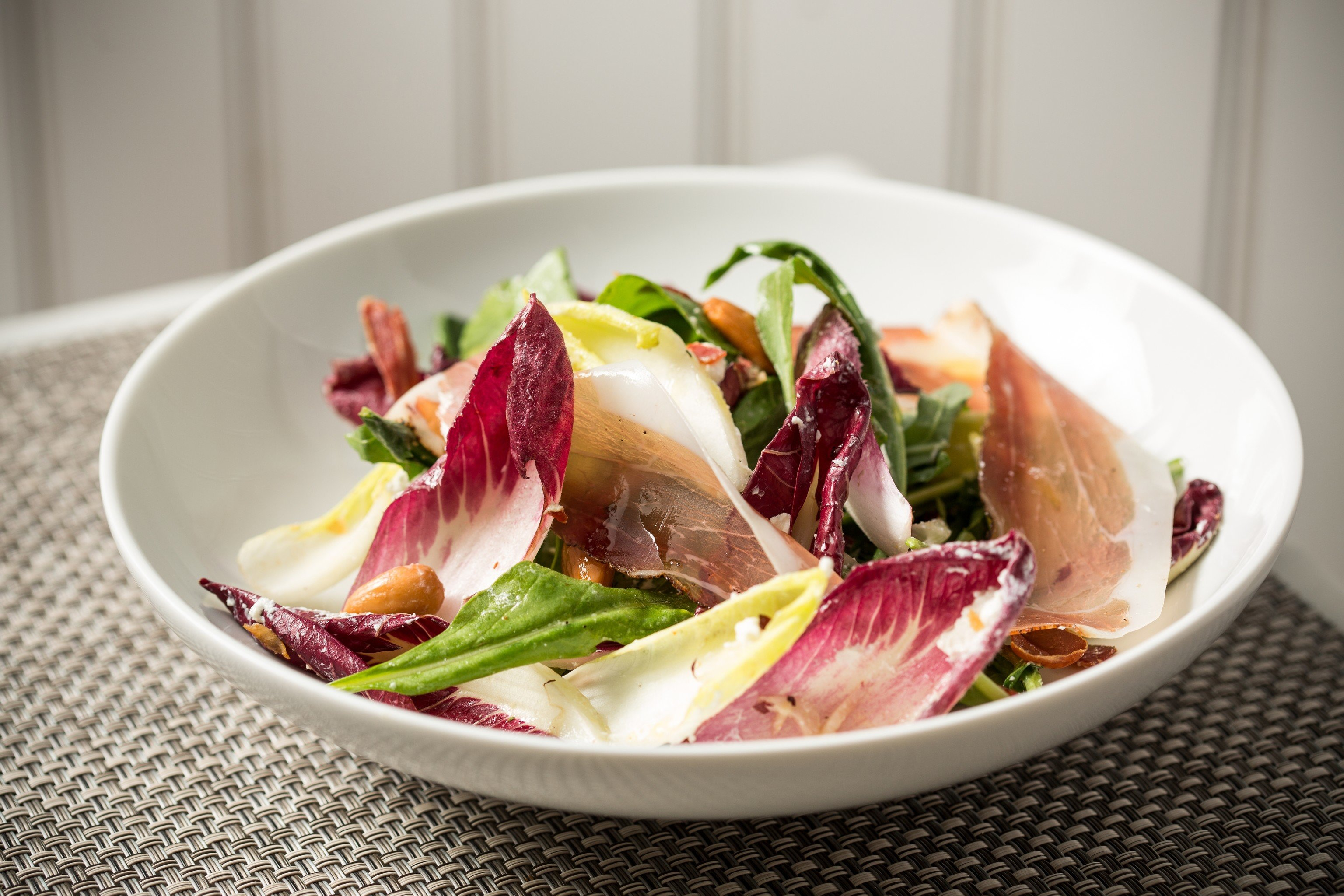 Food + Drink plate food dish salad produce vegetable shallot land plant meat meal prosciutto cuisine flowering plant dessert containing arranged