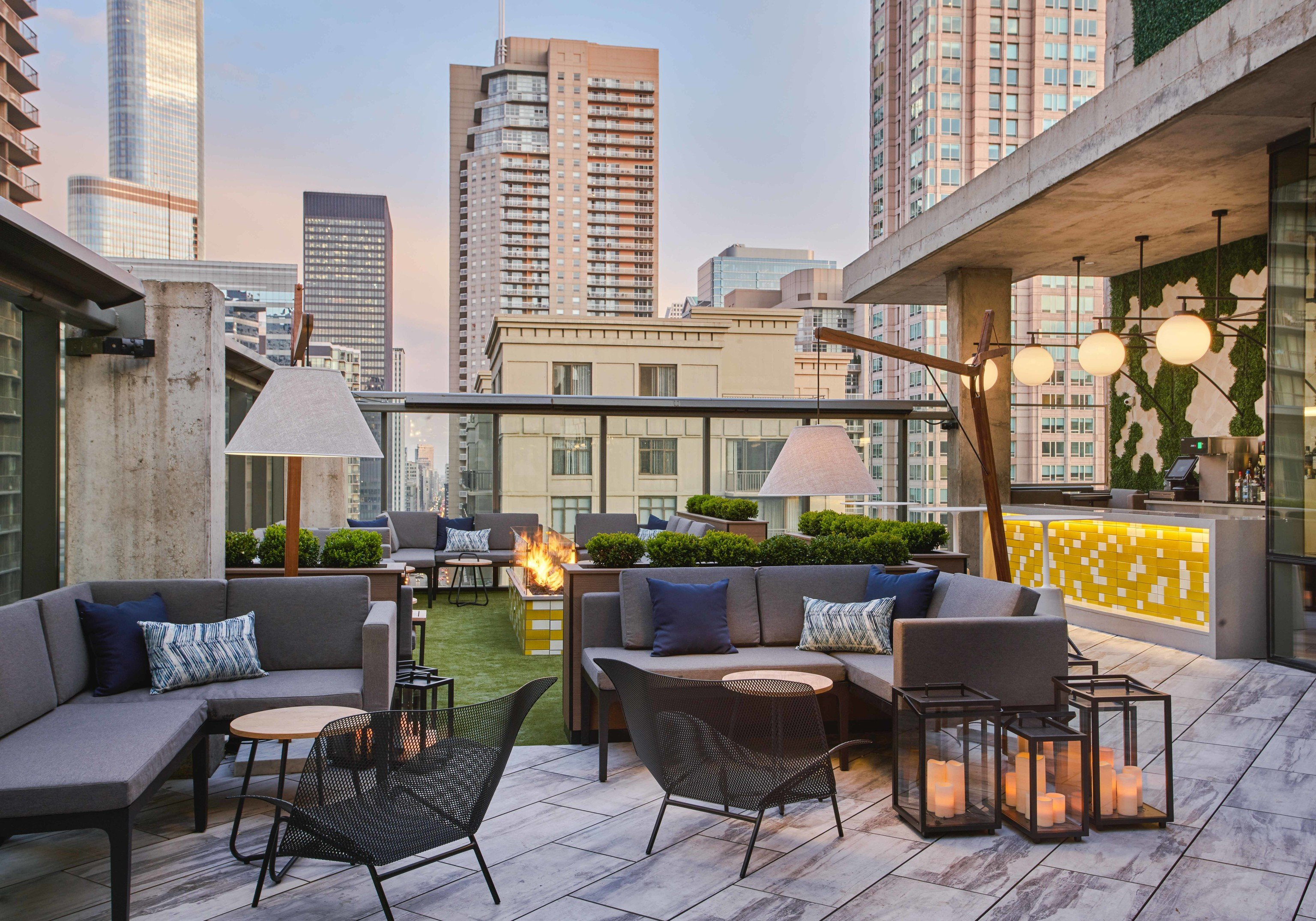 Arts + Culture Food + Drink Hotels Weekend Getaways building outdoor mixed use Patio furniture real estate interior design apartment outdoor structure roof living room table Balcony condominium penthouse apartment window Courtyard backyard interior designer area