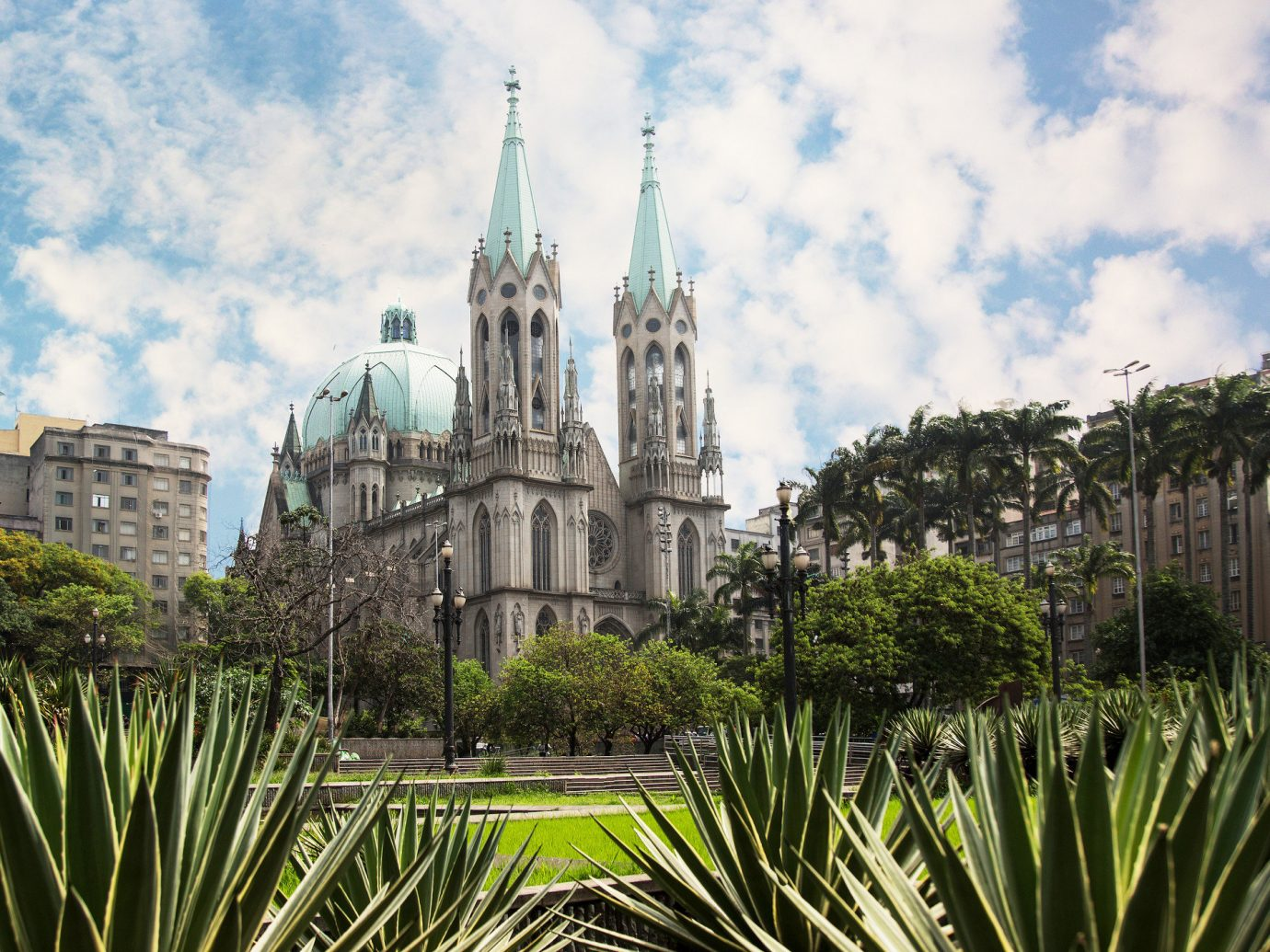 Beaches Brazil Trip Ideas outdoor sky landmark tree plant arecales cathedral grass palm tree building cloud tourist attraction City place of worship spire metropolis landscape tourism day