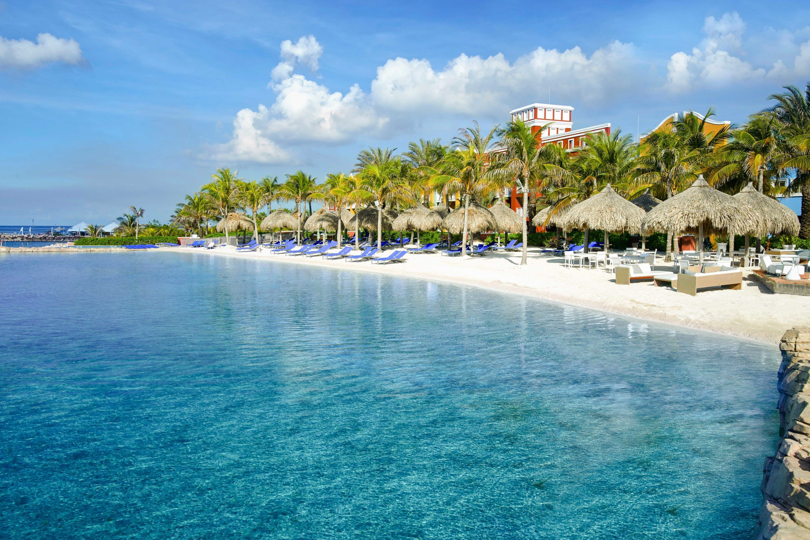 Boutique Hotels Romantic Getaways Romantic Hotels sky water outdoor Resort caribbean coastal and oceanic landforms tropics Sea Nature swimming pool leisure vacation resort town tourism palm tree Ocean bay shore Lagoon Island arecales Coast reef Beach cay tree cloud lined swimming day