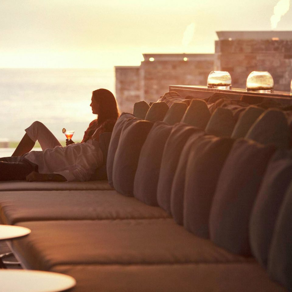 Scenic views Sunset Waterfront sofa restaurant seat