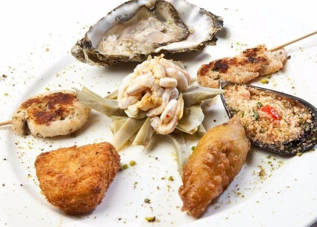 food plate Seafood fish cuisine meat animal source foods clams oysters mussels and scallops invertebrate