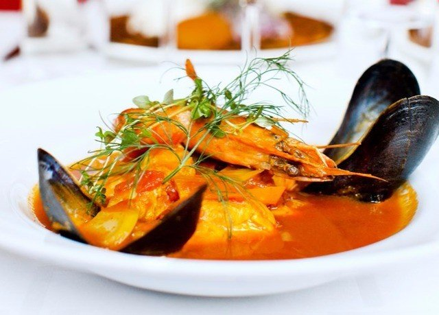 plate food carrot mussel bouillabaisse orange cuisine Seafood fish vegetable sliced thai food slice meat containing arranged shrimp stew fresh piece de resistance