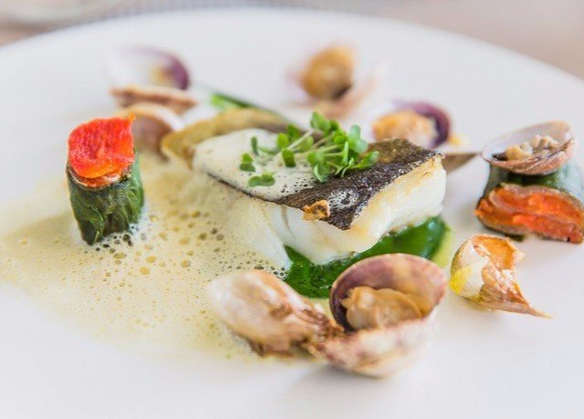 plate food piece slice hors d oeuvre Seafood cuisine fish mussel invertebrate clams oysters mussels and scallops vegetable sliced arranged piece de resistance