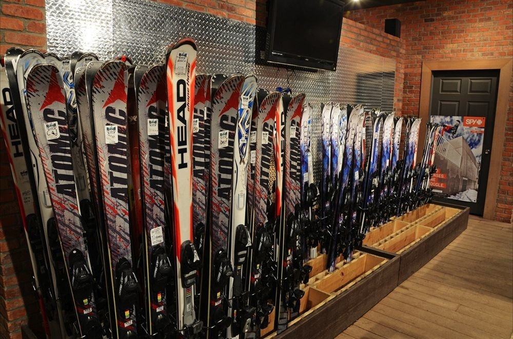 Ski lots lined rack bunch row full different assortment line containing
