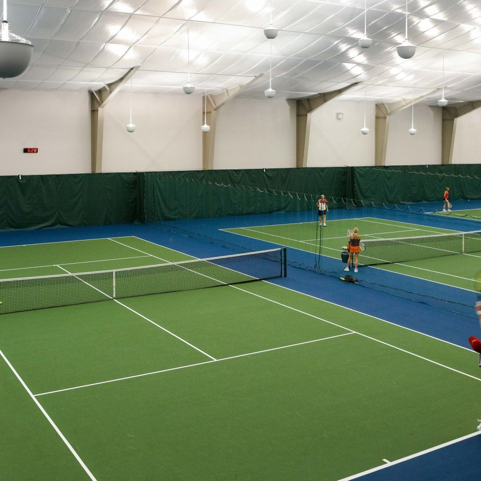 sport venue tennis court tennis sports racquet sport structure court Sport ball game leisure centre athletic game leisure net green tennis player line competition event arena real tennis tournament stadium match