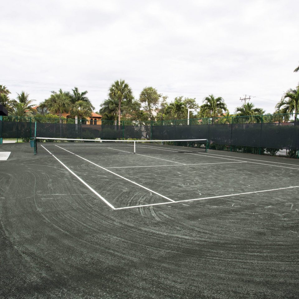 sky Sport athletic game tennis tree structure sport venue tennis court baseball field stadium race track asphalt walkway day
