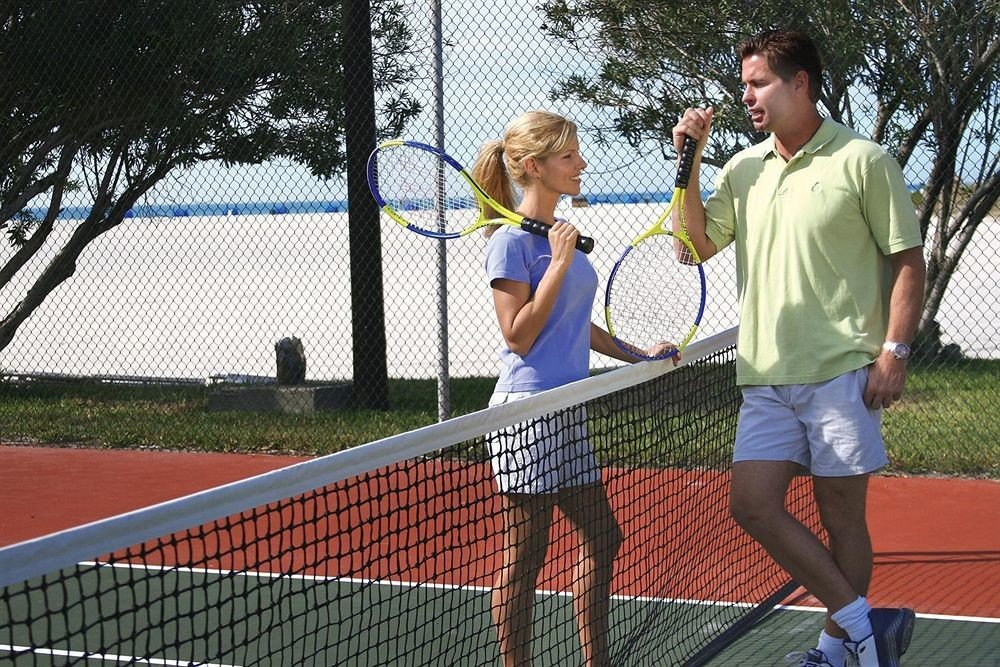 tennis tree Sport athletic game court human action sports standing net player racquet sport tournament athletics competition event