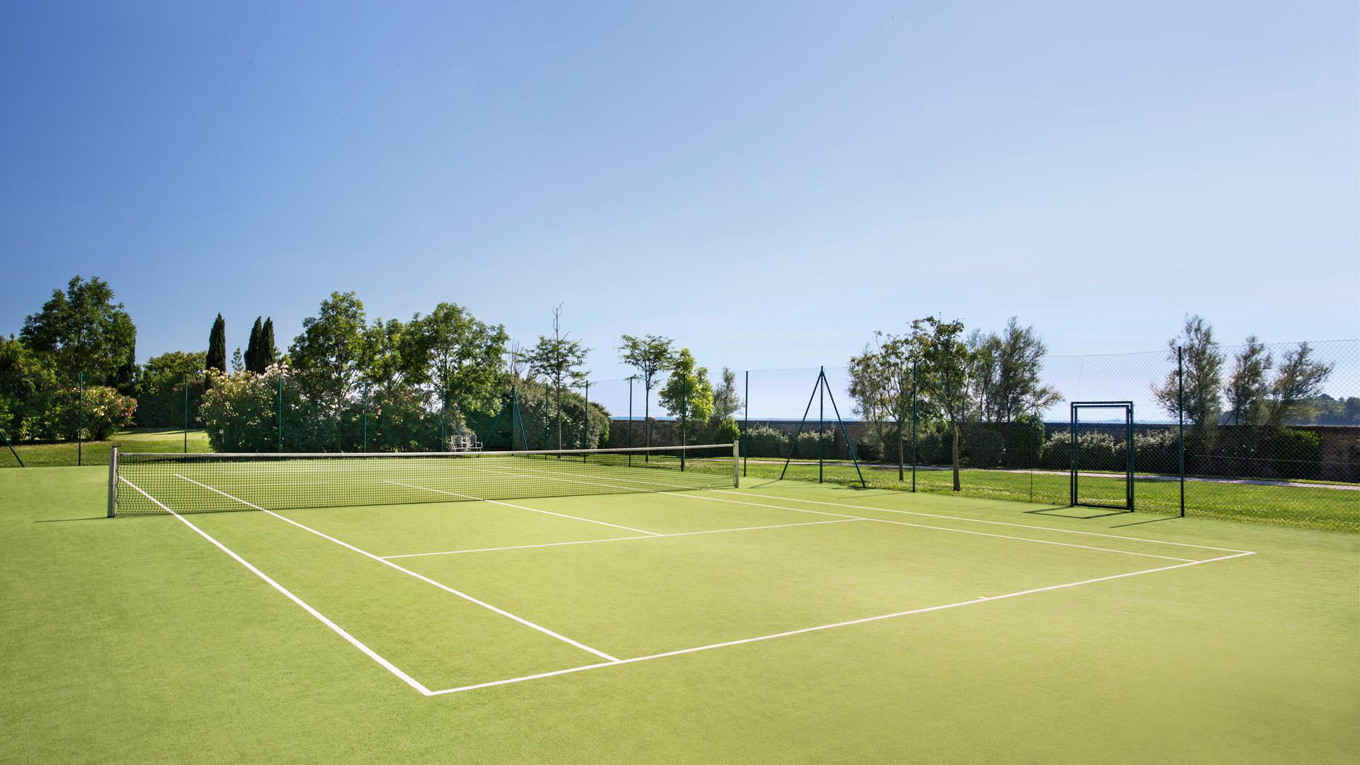 athletic game Sport sky grass tennis structure sport venue sports ball game tennis court baseball field soccer specific stadium stadium lawn golf course