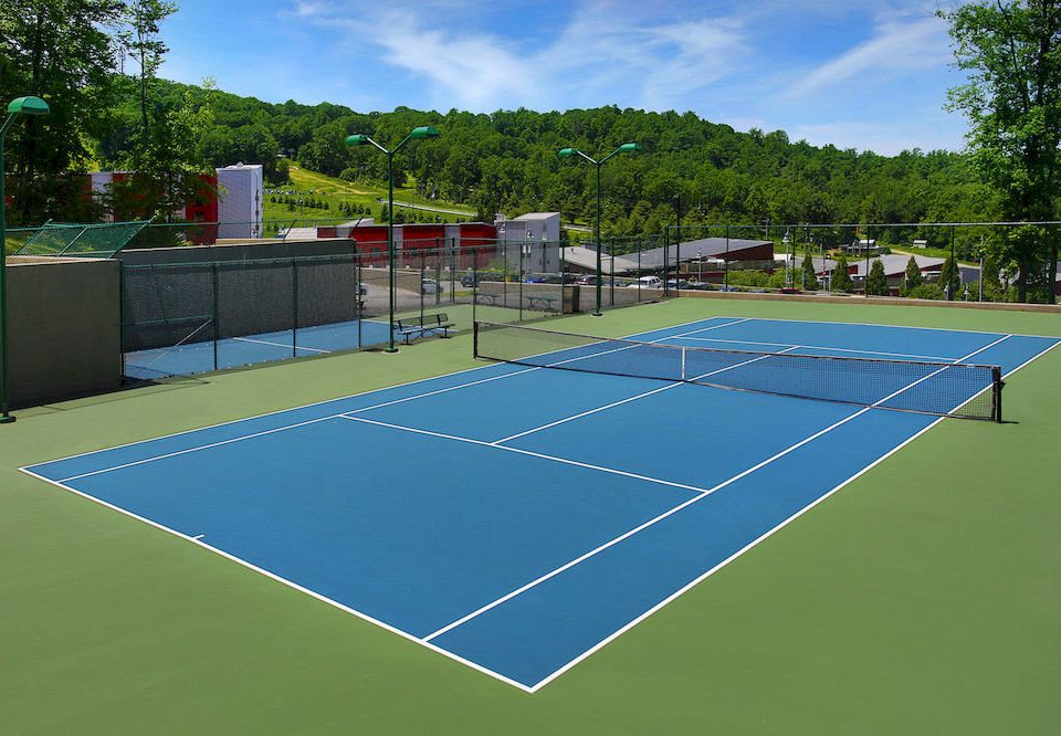 sky tree tennis athletic game structure Sport tennis court sports sport venue blue grass leisure centre baseball field soccer specific stadium green net baseball park racquet sport