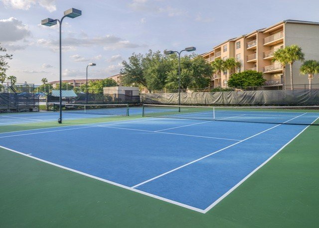 athletic game Sport tennis road court sky structure tennis court sport venue leisure centre baseball field sports soccer specific stadium net blue baseball park stadium