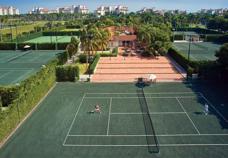 athletic game Sport sky tennis grass structure sport venue tennis court sports baseball park baseball field stadium soccer specific stadium racquet sport lawn