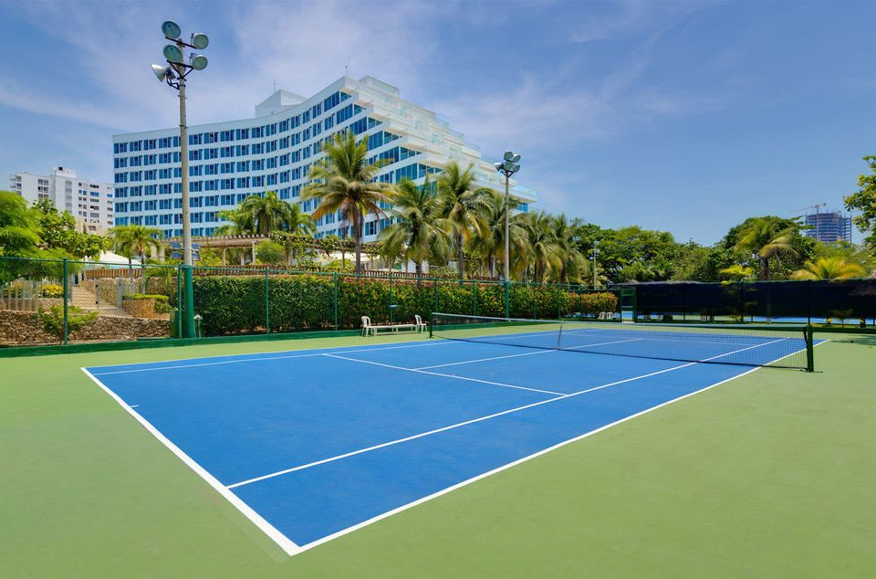 athletic game Sport tennis sky tree structure court sport venue tennis court leisure grass baseball field soccer specific stadium baseball park sports blue stadium net lawn