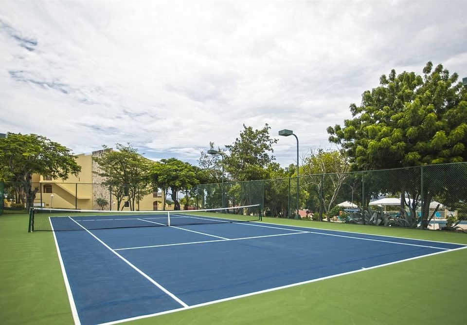 athletic game Sport tennis tree road structure court sport venue sports tennis court grass soccer specific stadium stadium basketball baseball field empty