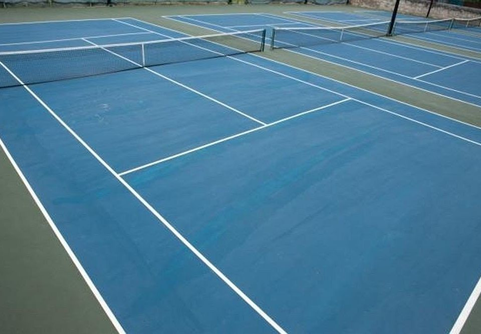athletic game Sport tennis court structure road blue tennis court sport venue leisure centre net soccer specific stadium baseball field flooring stadium match crowd