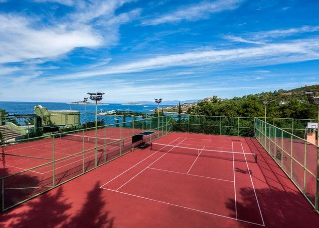 sky Sport athletic game tennis structure court sport venue red tennis court stadium baseball field sports net