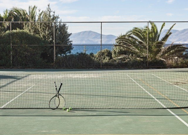 tennis athletic game Sport sky court racket structure net sport venue tennis court player outdoor structure stadium