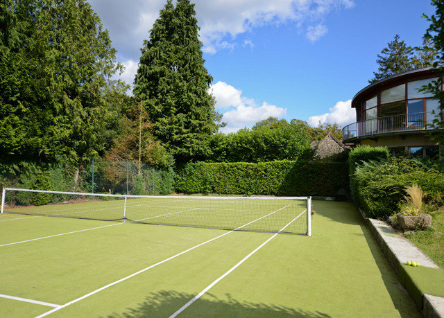 tree athletic game Sport sky tennis structure grass sport venue lawn tennis court sports