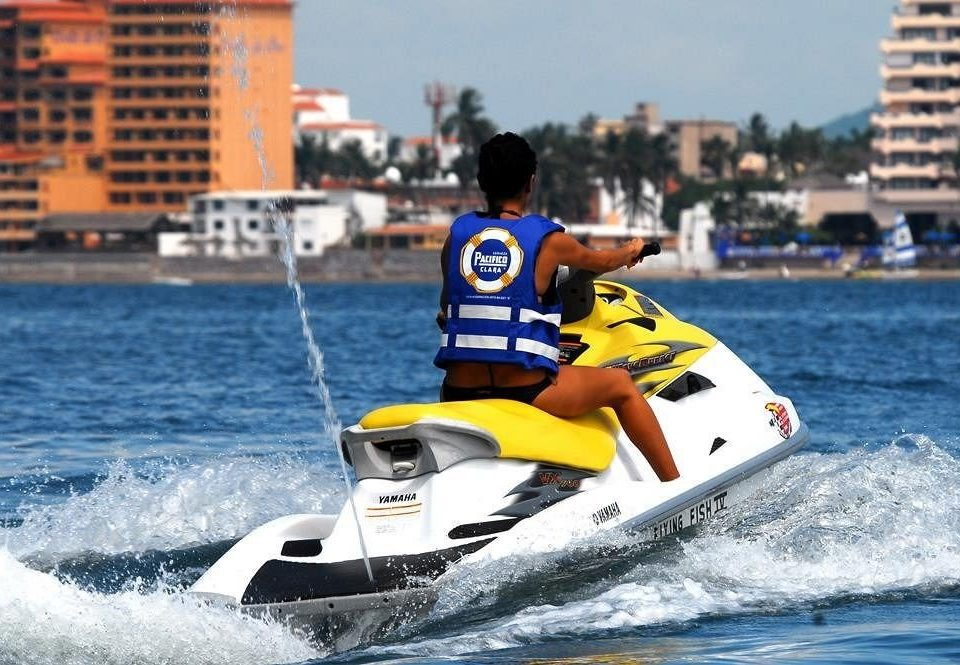 water boating vehicle riding personal water craft sports jet ski motorsport water sport powerboating yellow watercraft Sport sailing outdoor recreation recreation rider wave boat racing