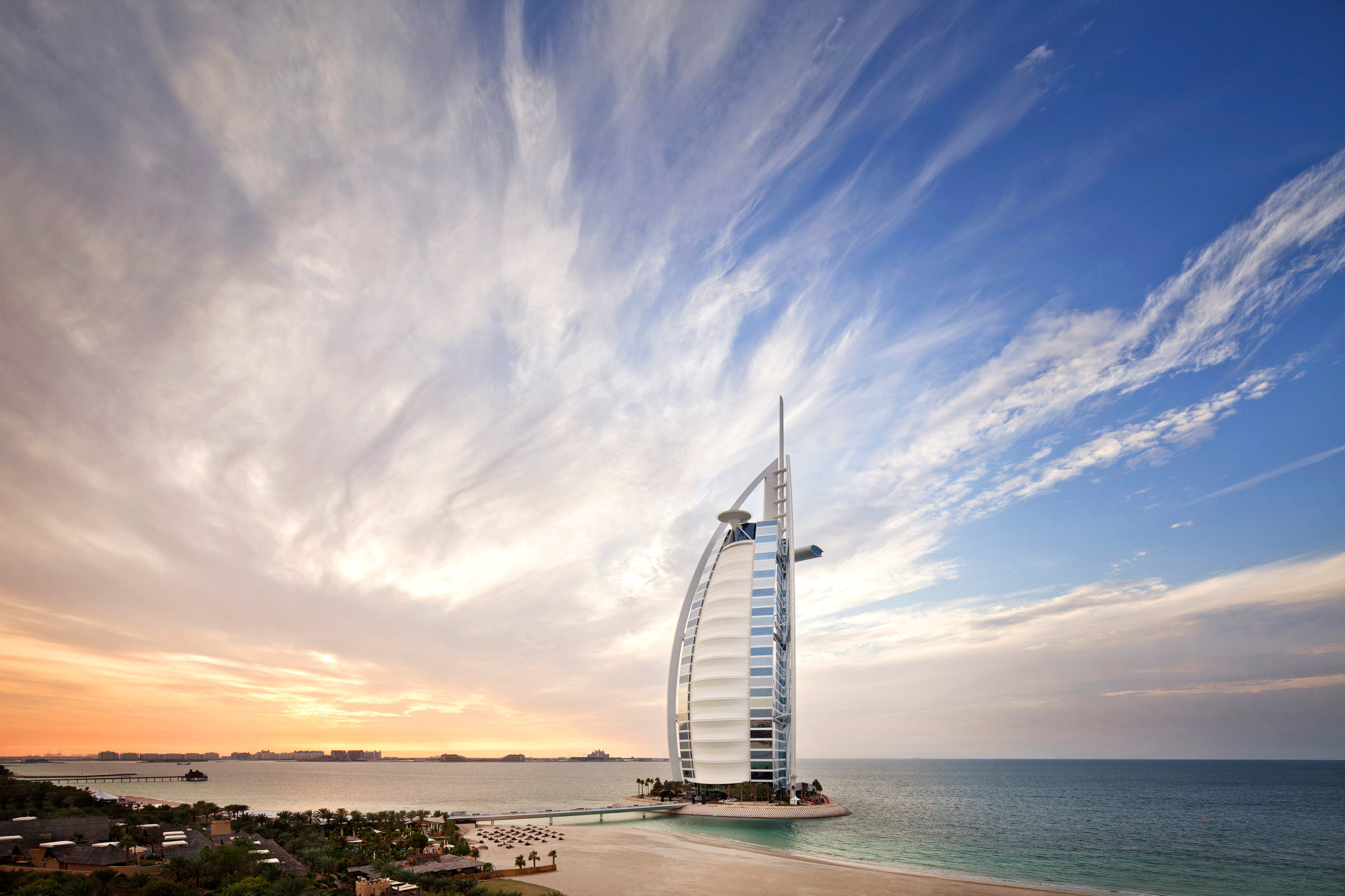 Dubai Hotels Luxury Travel Middle East sky outdoor water Sea cloud horizon Ocean tower vehicle Sunset Coast dusk sunlight evening bay wind mast shore sailing vessel clouds day distance