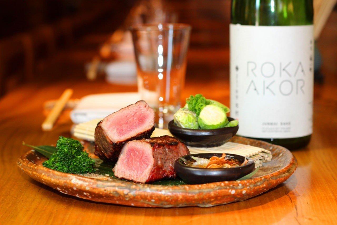 Food + Drink table food indoor dish meal wooden restaurant dinner cuisine meat brunch