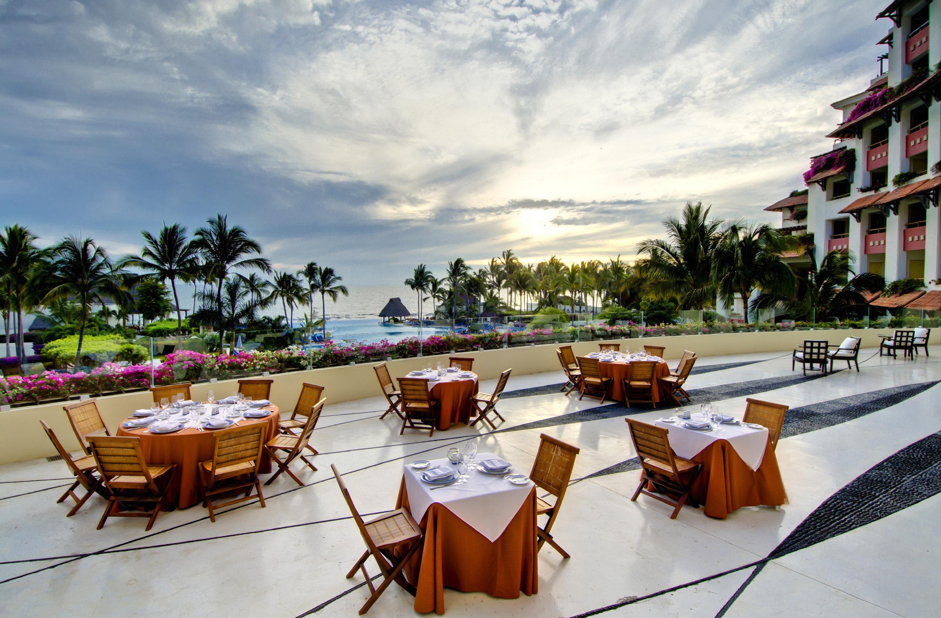 Balcony Beachfront Dining Drink Eat Hotels Outdoors Romance Romantic sky outdoor leisure chair vacation Resort Beach restaurant estate furniture