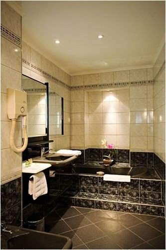 bathroom sink property home flooring cabinetry Suite toilet tile appliance tub tiled