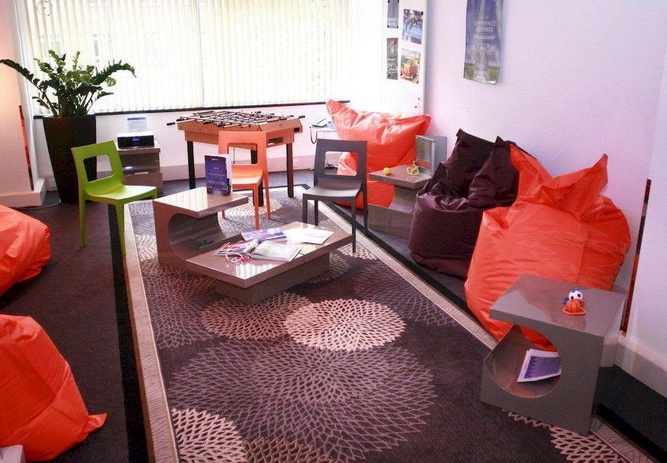 property orange living room home Suite cottage arranged