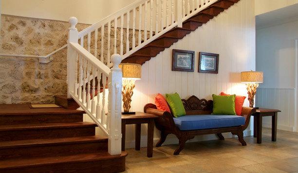 stairs property living room chair wood flooring flooring hardwood home handrail baluster laminate flooring Suite product house interior designer