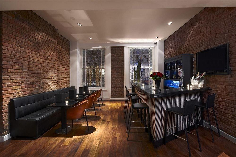 sofa property living room home hardwood wood flooring cottage Suite basement loft