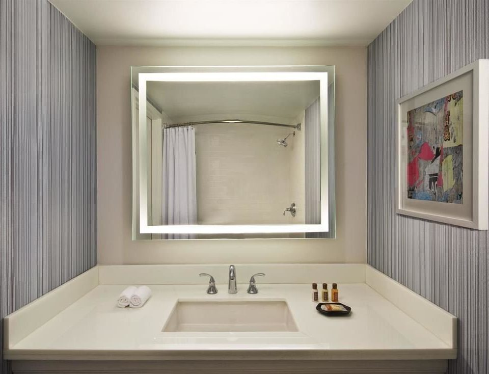 bathroom sink mirror home white plumbing fixture bathtub bathroom cabinet living room flooring Suite toilet clean