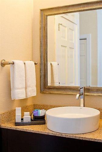 bathroom sink mirror bathtub plumbing fixture Suite flooring bidet bathroom cabinet tile vanity counter tan