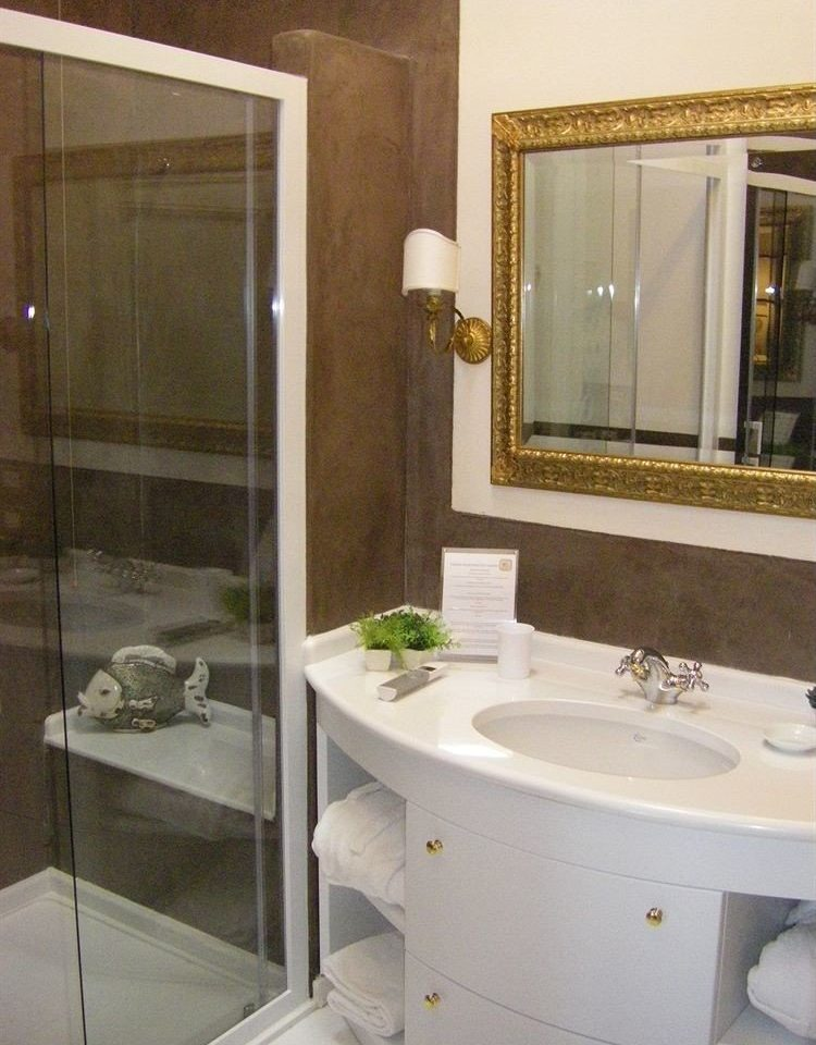 bathroom sink property bathtub plumbing fixture white bathroom cabinet bidet Suite flooring rack tan