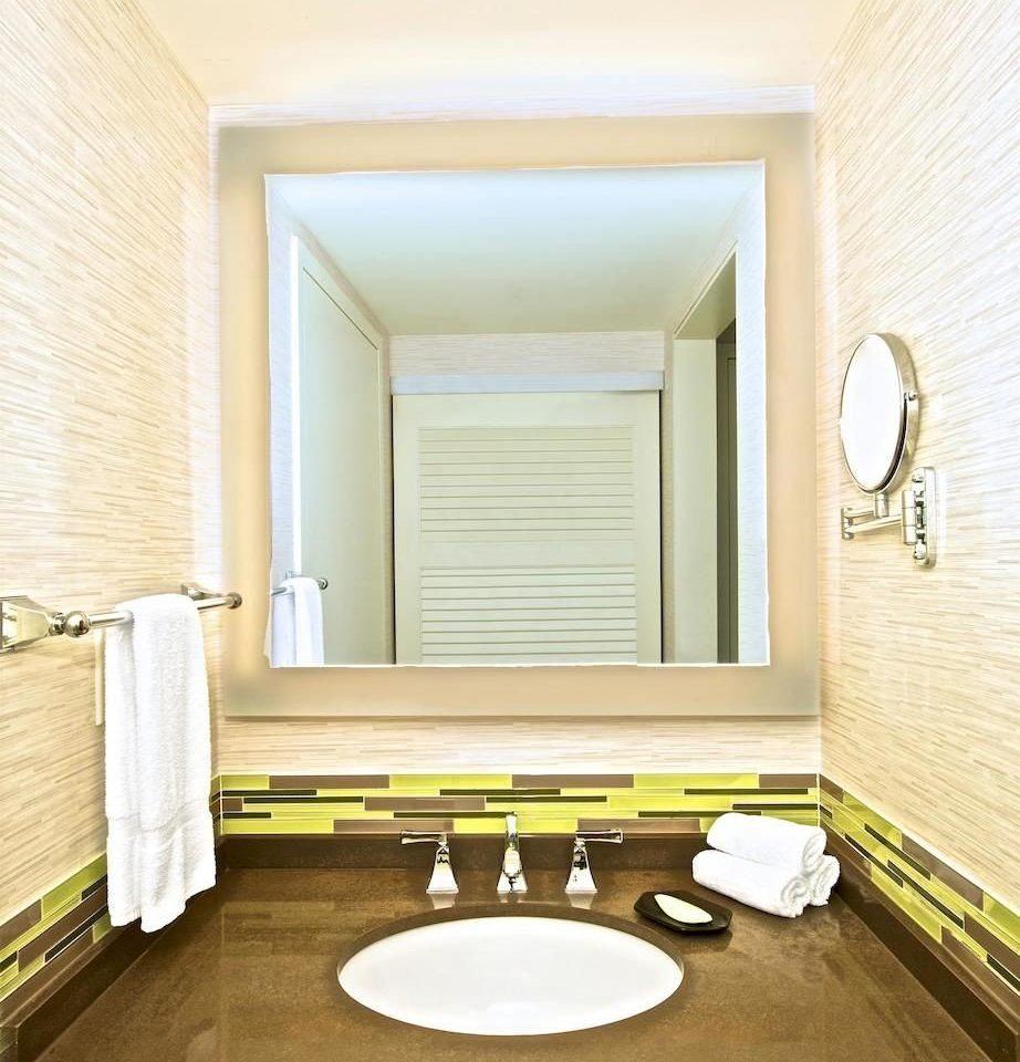 bathroom mirror sink hardwood home living room flooring Suite bathtub molding plumbing fixture bathroom cabinet