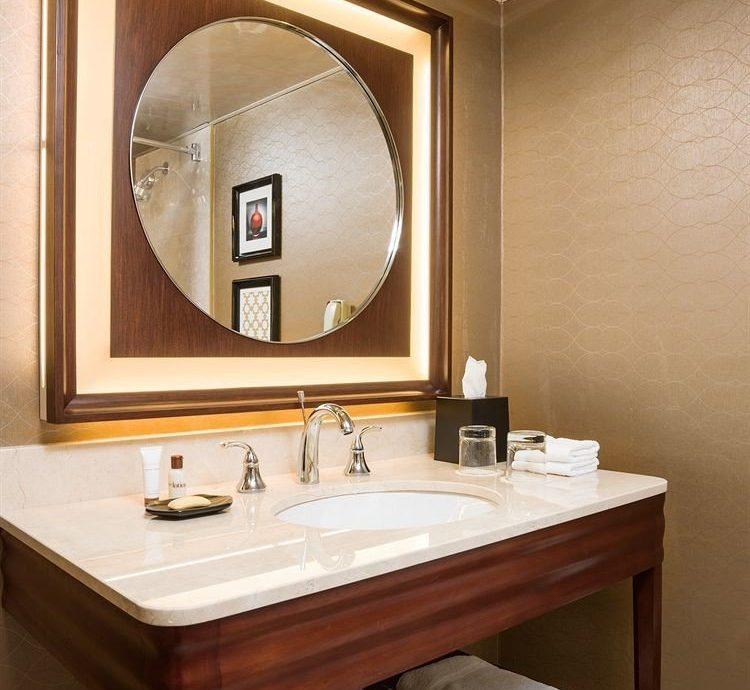 bathroom mirror sink plumbing fixture Suite cabinetry lighting bathroom cabinet