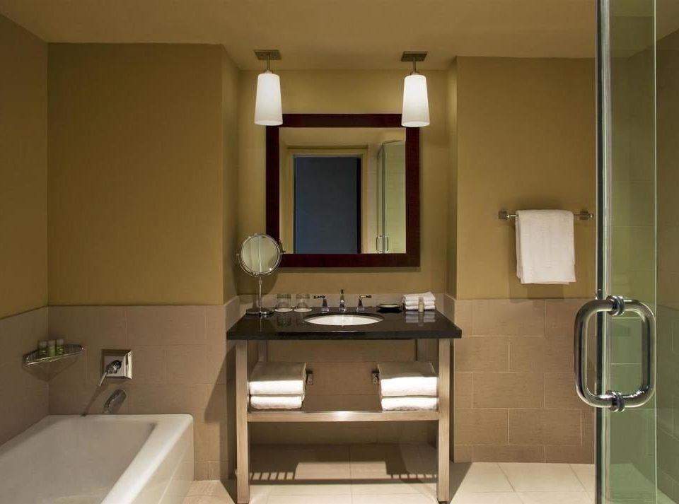 bathroom mirror sink property home cabinetry plumbing fixture Suite bathroom cabinet toilet tub