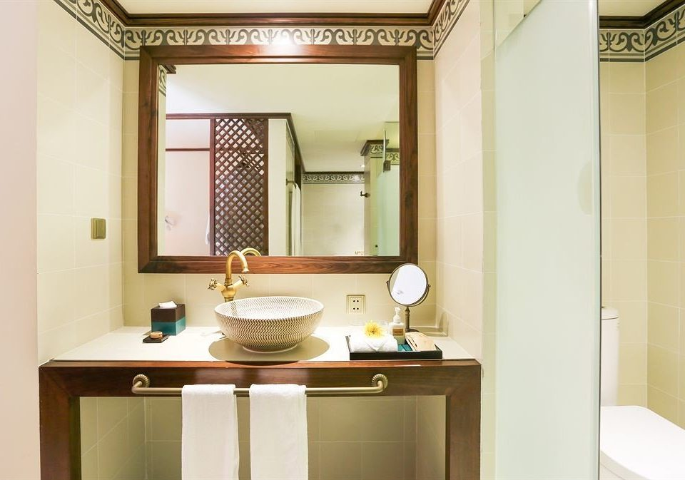 bathroom mirror property sink toilet home Suite bathroom cabinet cottage plumbing fixture cabinetry tiled