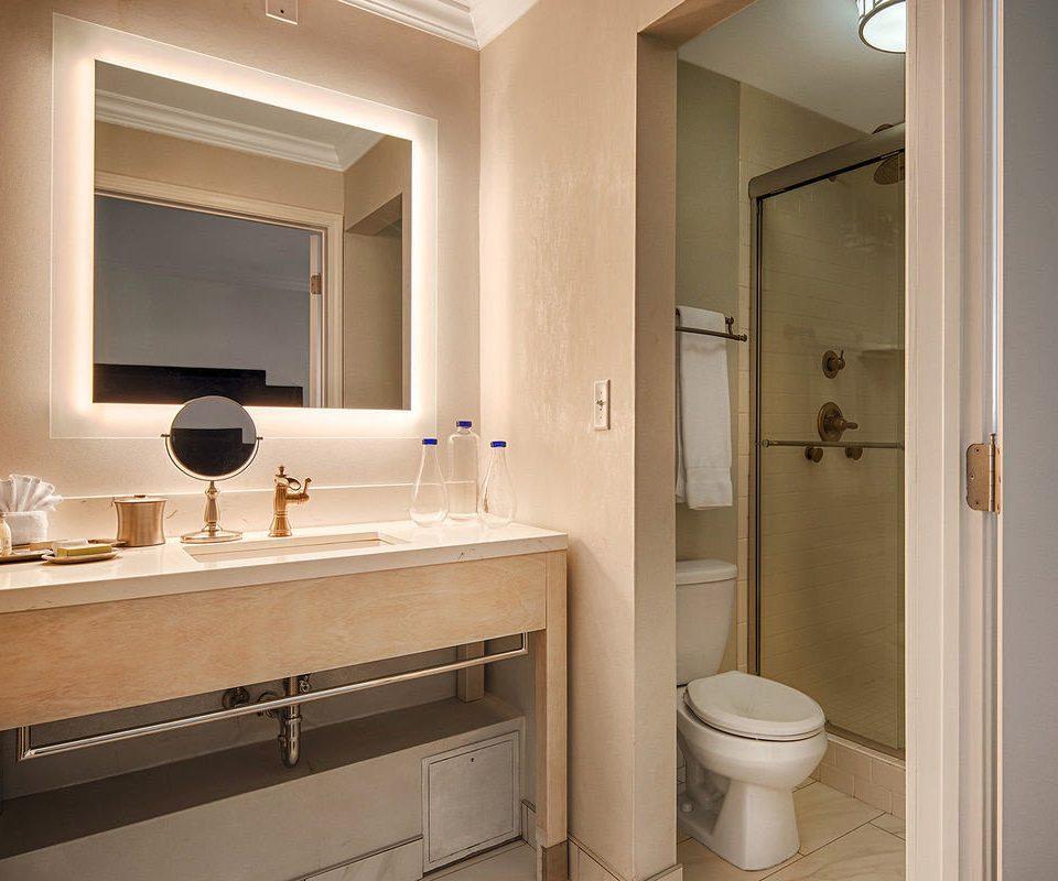 bathroom mirror sink property cabinetry toilet home plumbing fixture bathroom cabinet Suite