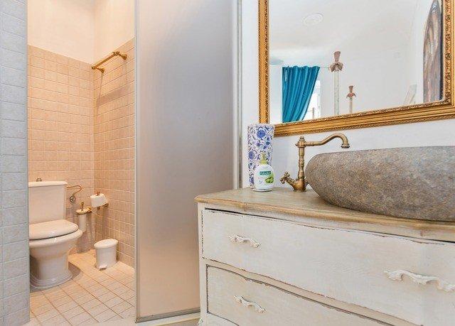bathroom Suite bathroom cabinet plumbing fixture flooring tan containing