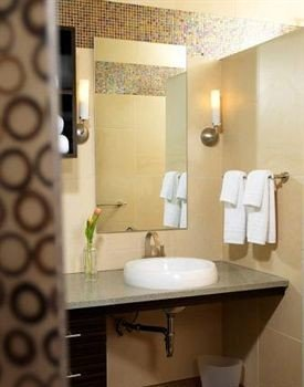 bathroom mirror sink property toilet shower towel plumbing fixture bathroom cabinet Suite rack tile tiled