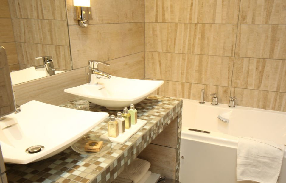 bathroom property toilet bathtub sink plumbing fixture bidet swimming pool countertop Suite cottage tiled