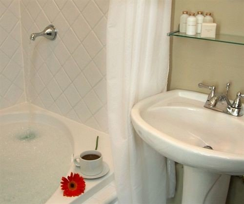 bathroom sink property toilet white bidet plumbing fixture bathtub Suite flooring