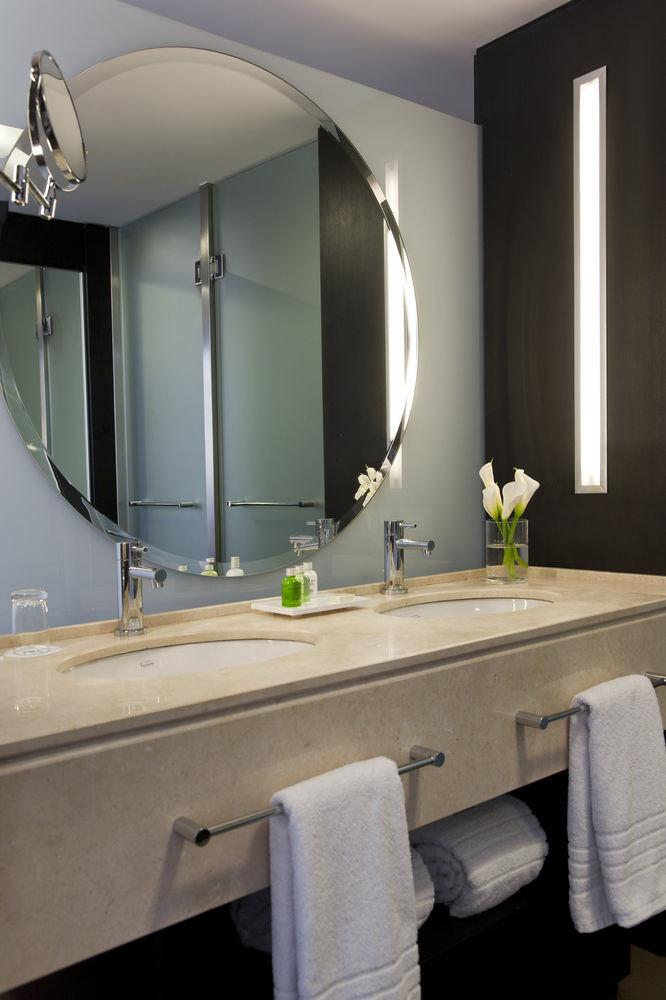 bathroom mirror sink plumbing fixture bathtub lighting home Suite bidet