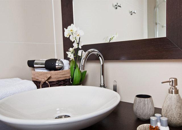 bathroom sink bidet plumbing fixture flooring bathtub ceramic Suite