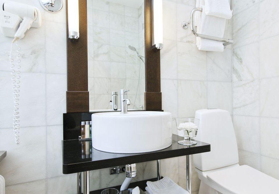 bathroom property toilet sink bidet plumbing fixture bathtub home Suite tile flooring cottage public toilet tiled