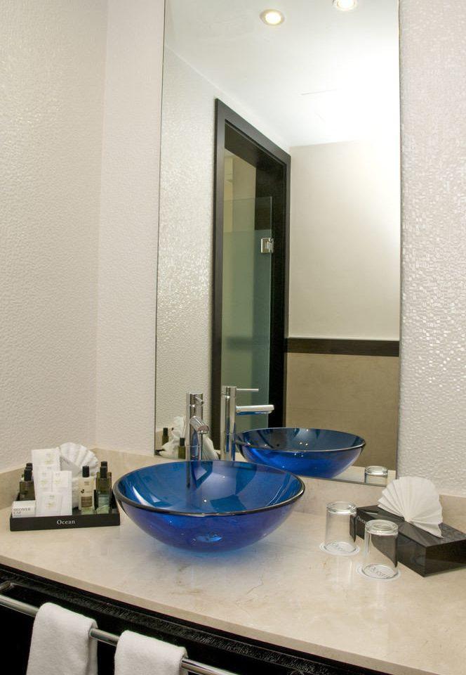 bathroom sink property home plumbing fixture counter blue Suite flooring bathtub
