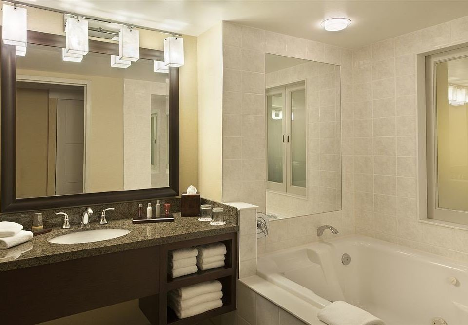 bathroom mirror sink property home cabinetry countertop Suite flooring double tub bathtub clean tile tan