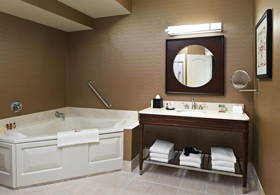 bathroom property sink home plumbing fixture Suite flooring cabinetry bathtub