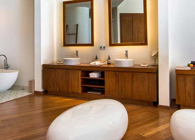 bathroom property hardwood flooring home bathtub wood flooring laminate flooring cottage sink cabinetry plumbing fixture Suite hard